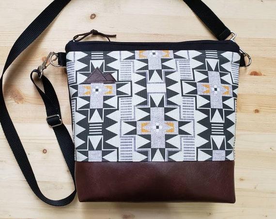 Large crossbody/Westward print=2 front pockets/Black canvas back/Black zipper/Black adjustable nylon strap/MT or Mountain