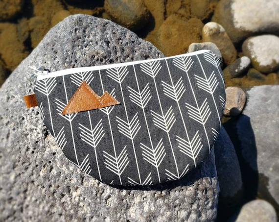 Half moon clutch/phone pouch/Black&white feathered front and back/Natural canvas liner/White zipper/Montana or Mountain patch/Vegan leather
