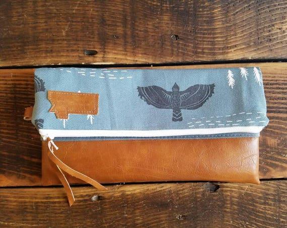 Montana Clutch - Hawk print/Blue, black & white/White zipper/Caramel vegan leather details/Gray canvas reverse/Foldover clutch/Handcrafted