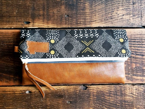 Foldover clutch/Black, white & olive mud cloth/Montana patch/Caramel brown vegan leather details/White zipper