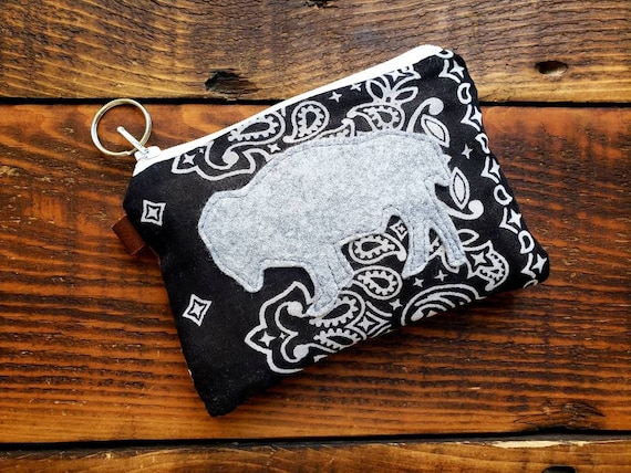 Coin/credit card pouch/Lightweight Black with white bandana print front/Brown waxed canvas back/White zipper/Wool felt bison patch