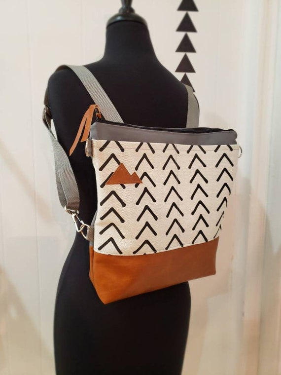 Convertible crossbody backpack/Flax ivory & black mud cloth=2 front pockets/Vegan leather/Gray canvas shell/Black zipper/Montana or MTN