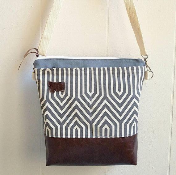 Large crossbody/Gray+ivory geo print/2 front pockets/Dark brown vegan leather/Gray canvas back/White zipper/Adjustable cotton strap/Montana