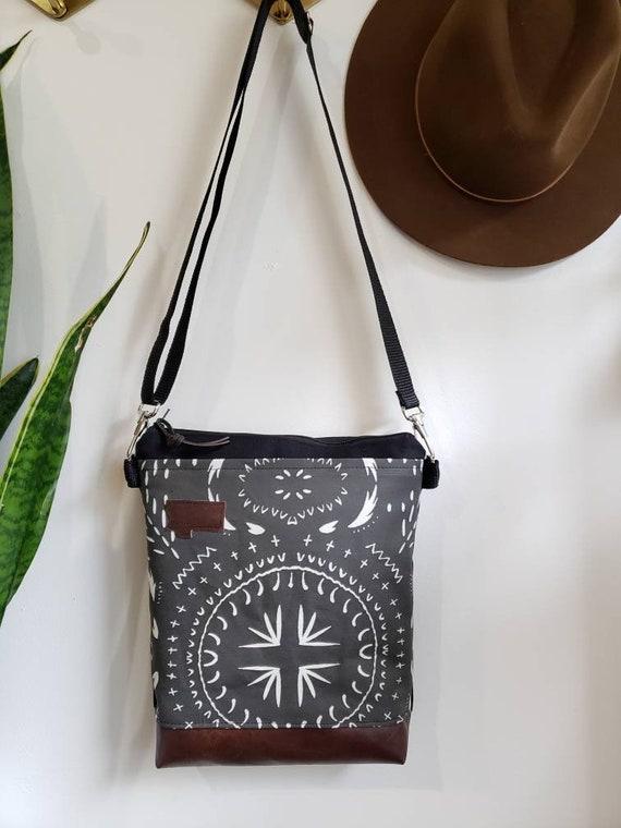 Medium crossbody/Bohemian print in charcoal = front pocket/Black zipper/Black canvas reverse/Black nylon adjustable strap
