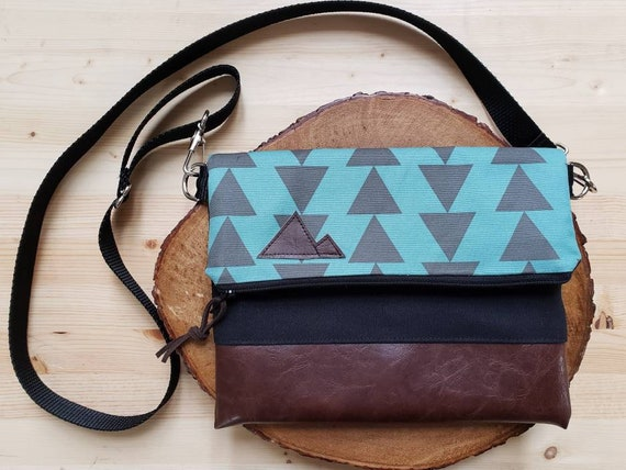 Foldover crossbody/Teal & charcoal triangles print/Black zipper/Black canvas reverse/Black nylon adjustable strap/Mountain or Montana patch