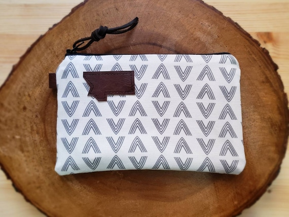3 size options/White & gray flock print pouch/printed front and back/Natural canvas liner/Black zipper/Mountain or Montana patch