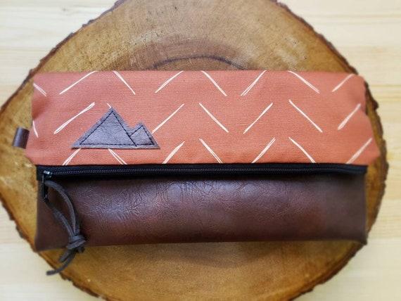 Foldover clutch/Chevron in rust & white print/Black canvas reverse/Black zipper/Montana or Mountain patch