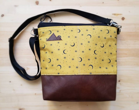 Large crossbody/Gold & navy moon print=2 front pockets/Black canvas back/Black zipper/Black adjustable nylon strap/MT or Mountain