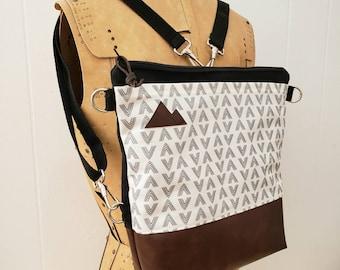 Convertible Backpack/Crossbody/White & gray flock print=2 front pockets/Black canvas/Black zip/Black adjustable nylon straps/MT or Mountain