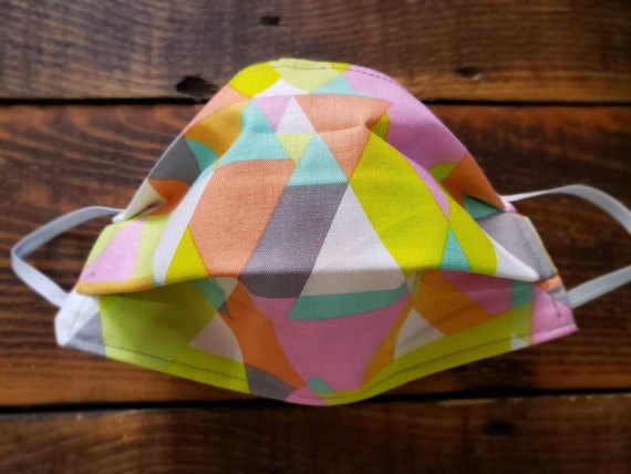 Colorful geo print/Basic fabric mask + elastic ear straps/NO returns, refunds, alterations or exchanges/Read description before purchasing