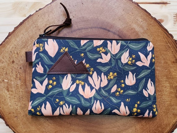 Spring floral pouch/3 size options/printed front and back/Natural canvas liner/Black zipper/Mountain or Montana patch/Vegan leather details