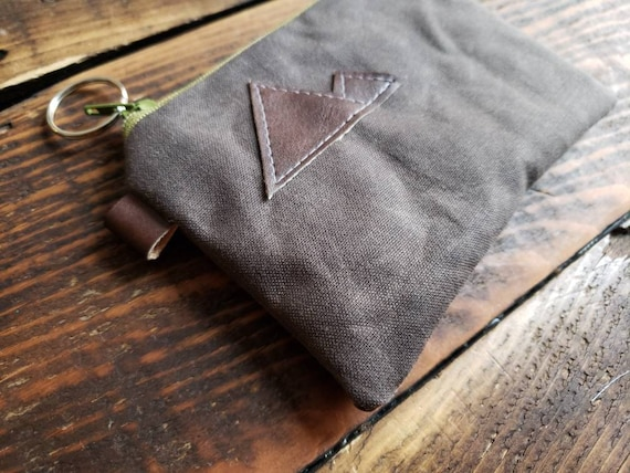 Coin pouch/credit card pouch/Dark brown waxed canvas front and back/Natural canvas liner/Green zipper/MT or MTN patch/Vegan leather