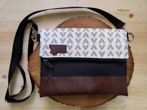 Foldover crossbody/White & gray flock print/Black zipper/Black canvas reverse/Black nylon adjustable strap/Mountain or Montana patch