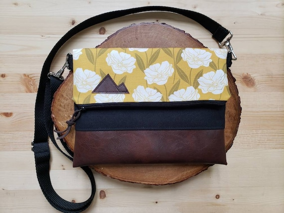 Foldover crossbody/Golden floral print/Black zipper/Black canvas reverse/Black nylon adjustable strap/Mountain or Montana patch