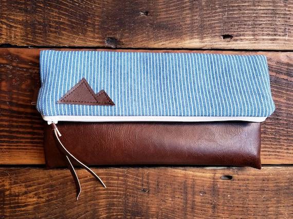 Foldover Clutch/Railroad stripe denim print/Mountain or Montana patch/Vegan leather details/White zipper/Black canvas reverse side