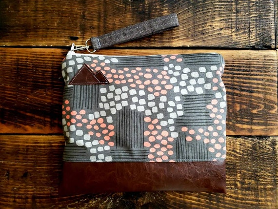 Wristlet clutch/Flathead lake print grays and peach print front and back/Vegan leather/Mountain or Montana patch/White zipper/Made to order
