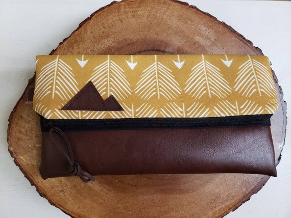 Foldover clutch/Yellow feathered arrows print/Black canvas reverse/Black zipper/Montana or Mountain patch