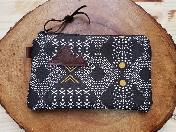 Mud cloth pouch/3 size options/printed front and back/Natural canvas liner/Black zipper/Mountain or Montana patch/Vegan leather details