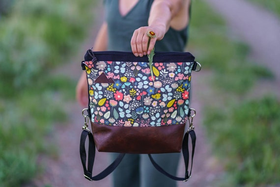 Convertible Backpack/Crossbody/Bold floral print=2 front pockets/Black canvas/Black zip/Black adjustable nylon straps/MT or Mountain