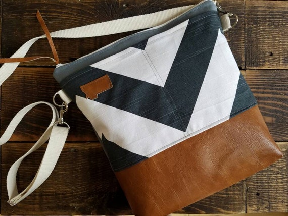 Large Crossbody/Blue-Gray & white Chevron print/2 front pockets/Caramel brown vegan leather/Gray canvas/White zipper/Adjustable strap