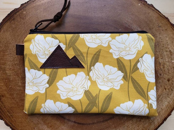 Golden floral pouch/3 size options/printed front and back/Natural canvas liner/Black zipper/Mountain or Montana patch/Vegan leather details