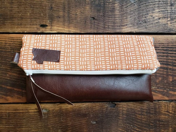 Foldover Clutch/Orange & white fall print/Gray canvas reverse/Montana or Mountain patch/Veegan leather details/White zipper