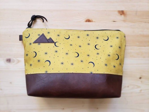 Travel bag/Gold & navy moons print front and back/Flat bottom/Black zipper/Montana or mountain patch