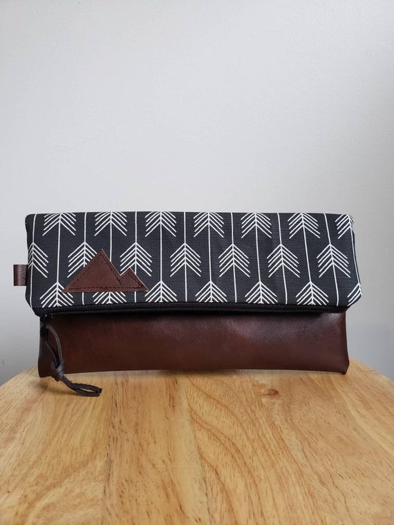 Foldover clutch/True North print in black with white arrows/Black canvas reverse/Black zipper/Montana or Mountain patch