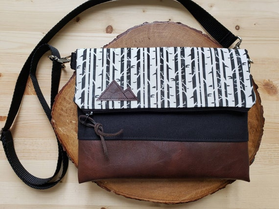 Foldover crossbody/Birch black & white print/Black zipper/Black canvas reverse/Black nylon adjustable strap/Mountain or Montana patch