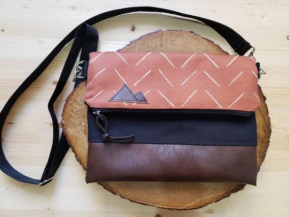 Foldover crossbody/Chevron in rust & white print/Black zipper/Black canvas reverse/Black nylon adjustable strap/Mountain or Montana patch