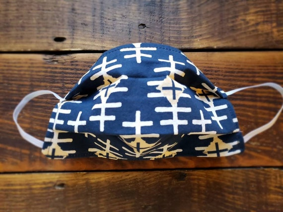 Navy swiss print/Basic fabric mask + elastic ear straps/NO returns, refunds, alterations or exchanges/Read description before purchasing