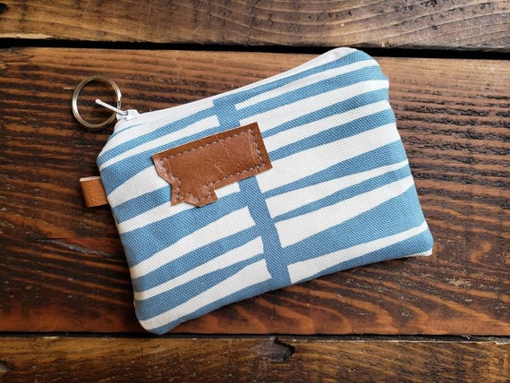 Coin pouch/credit card pouch/Blue & white zag print front and back/Natural canvas liner/White zipper/Montana or Mountain patch/Vegan leather
