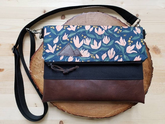 Foldover crossbody/Spring floral print/Black zipper/Black canvas reverse/Black nylon adjustable strap/Mountain or Montana patch
