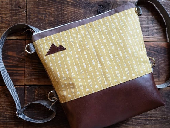 Convertible Backpack+Crossbody/Arrows print in gold=2 front pockets/Vegan leather/Taupe canvas shell/White zipper/Montana or Mountain patch