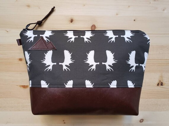 Travel bag/Charcoal gray moose antlers print front and back/Flat bottom/Black zipper/Montana or mountain patch