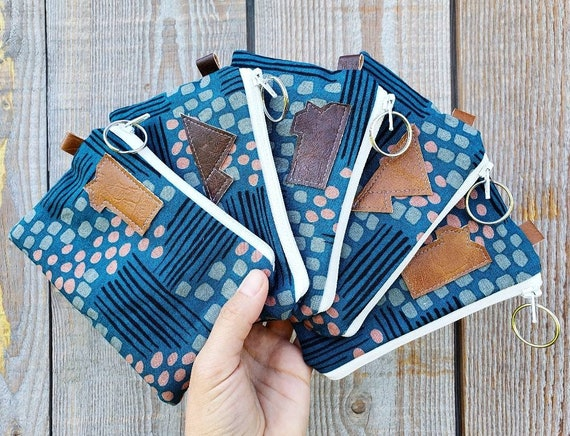 One Coin/credit card pouch/Flathead lake print in blues front and back/Natural canvas liner/White zipper/Montana or mountain patch