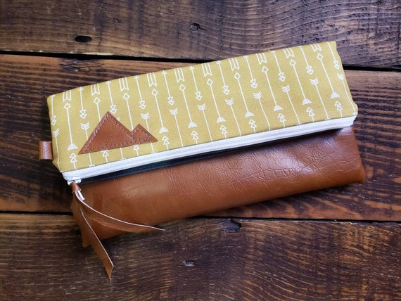 Foldover clutch/Arrows print in gold and white/Gray canvas reverse/White zipper/ Caramel brown vegan leather details/Made to order