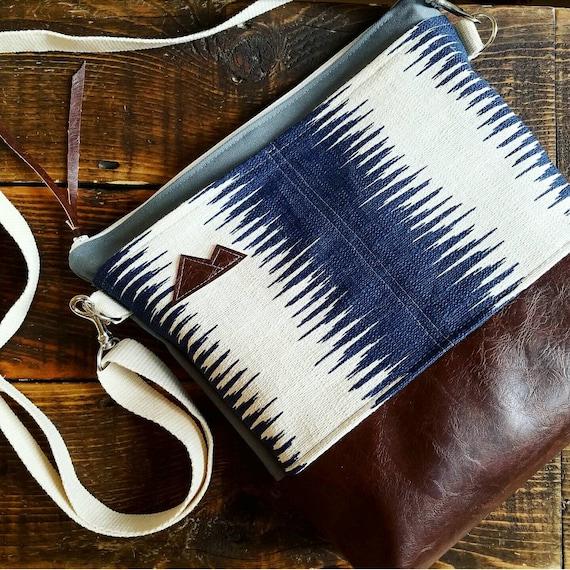 Large crossbody/MTN/Navy & ivory echo print/2 front pockets/Dark brown vegan leather/Gray canvas back/White zipper/Adjustable cotton strap