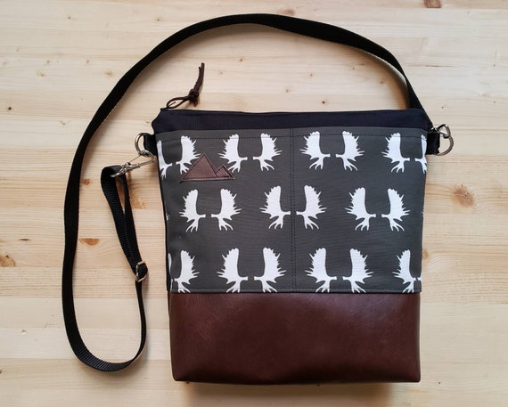 Large crossbody/Charcoal gray moose antlers print=2 front pockets/Black canvas back/Black zipper/Black adjustable nylon strap/MT or Mountain