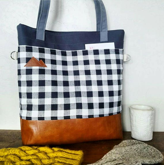 Large tote/Black & white plaid canvas print/Caramel brown vegan leather/Graphite gray bull denim/Gray canvas straps/4 pockets/Mountain patch