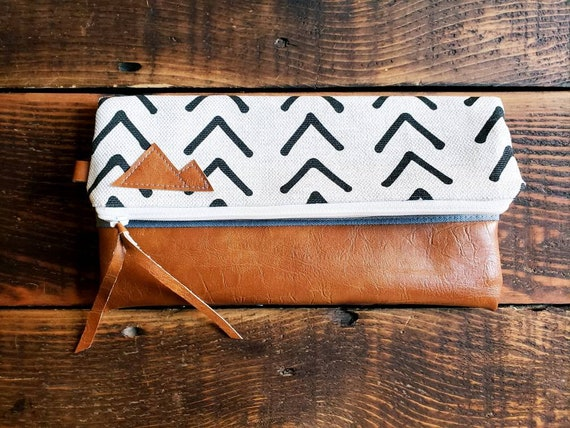 Foldover Clutch/Flax mud cloth print in tan and brown/Mountain patch/Caramel brown vegan leather details/White zipper