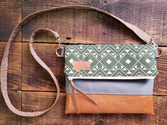 Foldover crossbody/Forest print/Vegan leather details/White zipper/Gray canvas reverse/Brown linen strap/Montana or Mountain patch