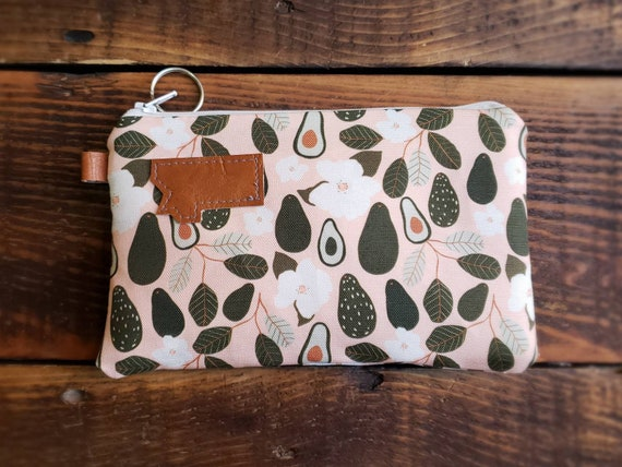 Phone pouch/Avacado print on peach front and back/Natural canvas liner/White zipper/Montana or Mountain patch/Vegan leather details