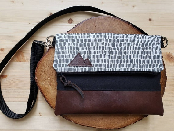 Foldover crossbody/Dashing gray & white print/Black zipper/Black canvas reverse/Black nylon adjustable strap/Mountain or Montana patch