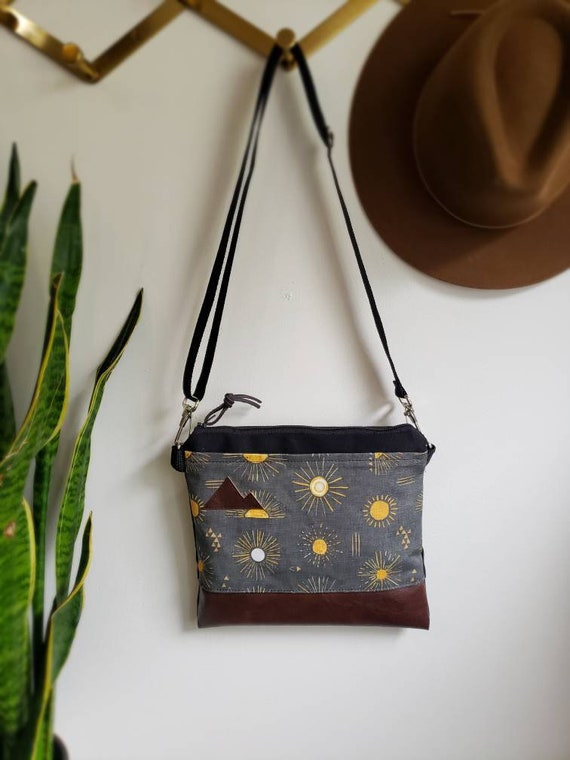 Small crossbody/Shine print in charcoal = front pocket/Black zipper/Black canvas reverse/Black nylon adjustable strap/Mountain or MT patch