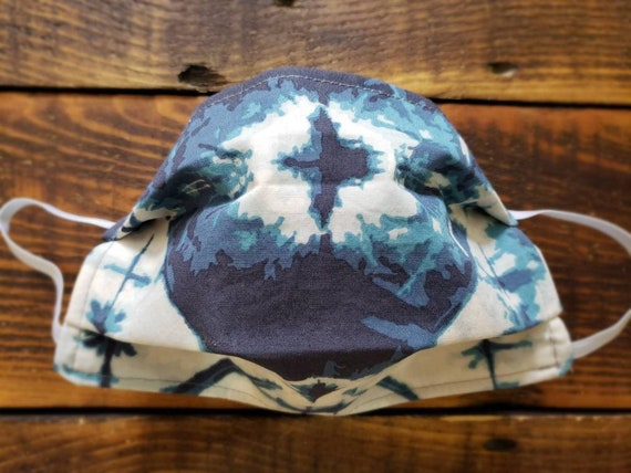 Blue tie dye print/Basic fabric mask + elastic ear straps/NO returns, refunds, alterations or exchanges/Read description before purchasing