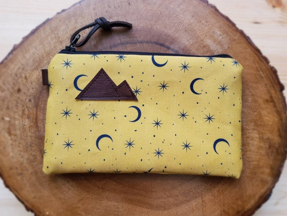 Gold & navy moons pouch/3 size options/printed front and back/Natural canvas liner/Black zipper/Mountain or MT patch/Vegan leather details