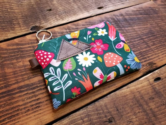 Lightweight cotton/Green garden floral print front and back/Natural canvas liner/White zipper/Silver key ring zipper pull/3 size options