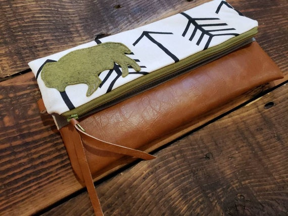 Bison foldover Clutch/White with black arrows print/Gray canvas reverse/Caramel vegan leather/Green wool felt bison/Green zipper/Made in MT