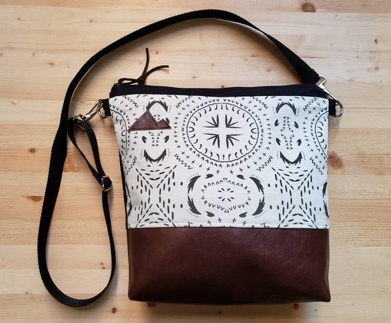 Large crossbody/Ivory & black bohemian print=2 front pockets/Black canvas back/Black zipper/Black adjustable nylon strap/MT or Mountain